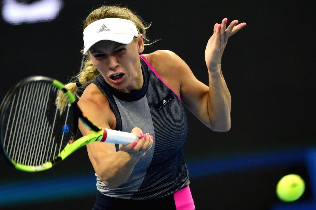 BEIJING, Oct. 5, 2017 - Caroline Wozniacki of Denmark returns the ball during the women's singles third round match against Petra Kvitova of Czech Republic at the China Open tennis tournament in ...