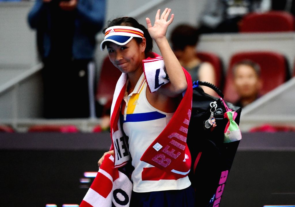 BEIJING, Oct. 5, 2017 - Peng Shuai of China waves to the spectators after she retired due to injury inthe women's singles third round match against Jelena Ostapenko of Latvia at the China Open tennis ...