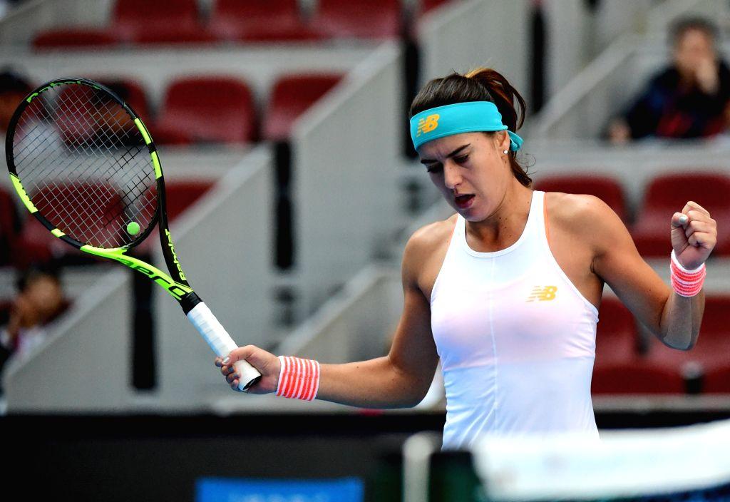 BEIJING, Oct. 5, 2017 - Sorana Cirstea of Romania celebrates during the women's singles third round match against Karolina Pliskova of Czech Republic at the China Open tennis tournament in Beijing on ...
