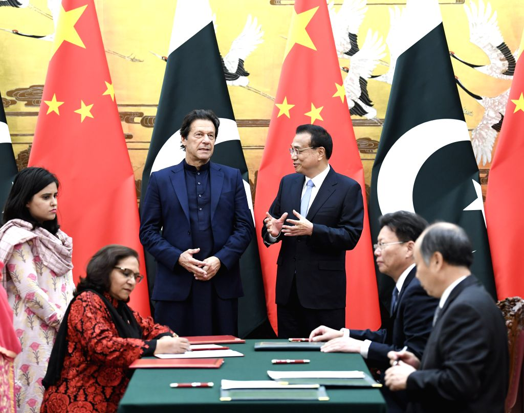BEIJING, Oct. 8, 2019 - Chinese Premier Li Keqiang and visiting Pakistani Prime Minister Imran Khan witness the signing of a series of cooperation documents after their talks in Beijing, capital of ... - Imran Khan