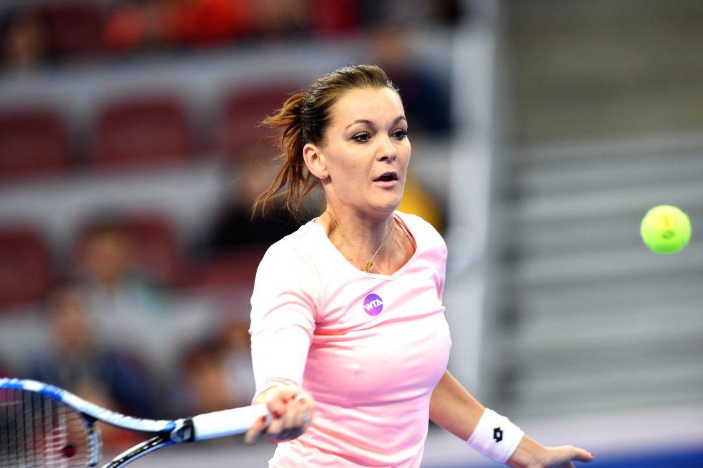 BEIJING, Oct. 9, 2016 - Agnieszka Radwanska of Poland hits a return to Johanna Konta of Britain during the women's singles final at the China Open tennis tournament in Beijing, capital of China, Oct. ...