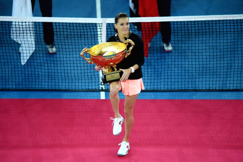 BEIJING, Oct. 9, 2016 - Agnieszka Radwanska of Poland attends the awarding ceremony for the women's singles final at the China Open tennis tournament in Beijing, capital of China, Oct. 9, 2016. ...