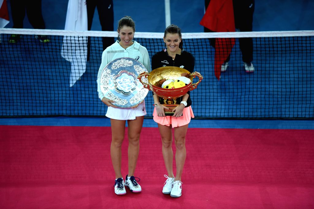 BEIJING, Oct. 9, 2016 - Agnieszka Radwanska (R) of Poland and Johanna Konta of Britain pose for photos during the awarding ceremony for the women's singles final at the China Open tennis tournament ...