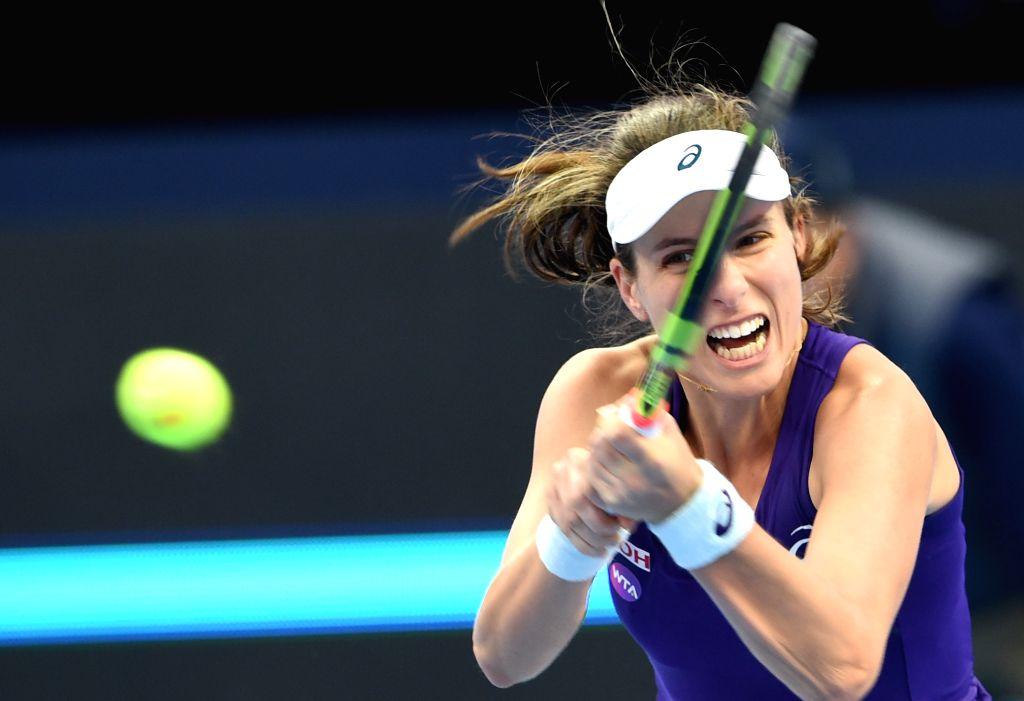 BEIJING, Oct. 9, 2016 - Johanna Konta of Britain hits a return to Agnieszka Radwanska of Poland during the women's sinlges final of the China Open tennis tournament in Beijing, capital of China, Oct. ...