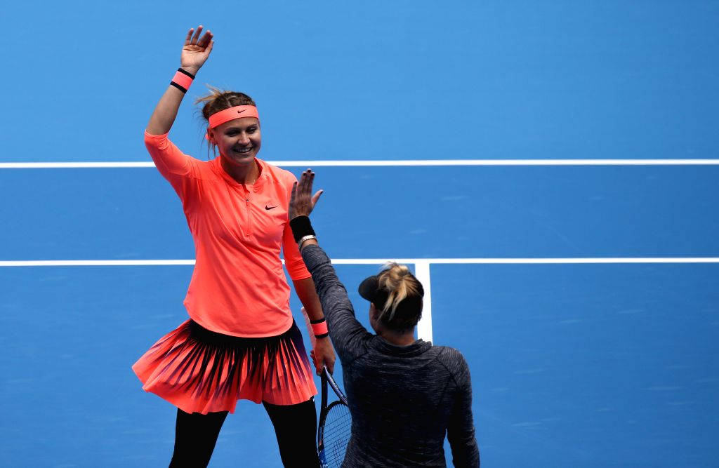 BEIJING, Oct. 9, 2016 - Lucie Safarova (L) of the Czech Republic and Bethanie Mattek-Sands of the United States celebrate after the women's doubles final against Caroline Garcia and Kristina ...