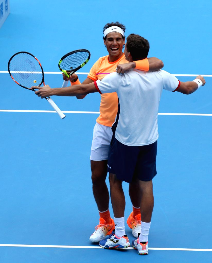 BEIJING, Oct. 9, 2016 - Spain's Rafael Nadal (back) and Pablo Carreno Busta celebrate after defeating Jack Sock of the United States and Bernard Tomic of Australia in the men's doubles final at the ...