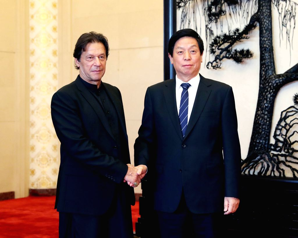 BEIJING, Oct. 9, 2019 - Li Zhanshu, chairman of the Standing Committee of the National People's Congress (NPC), meets with Pakistani Prime Minister Imran Khan at the Great Hall of the People in ... - Imran Khan