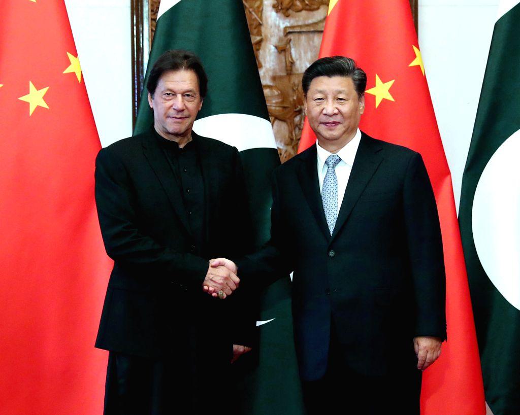 BEIJING, Oct. 9, 2019 (Xinhua) -- Chinese President Xi Jinping meets with Pakistani Prime Minister Imran Khan at the Diaoyutai State Guesthouse in Beijing, capital of China, Oct. 9, 2019. (Xinhua/Liu Weibing/IANS) - Imran Khan