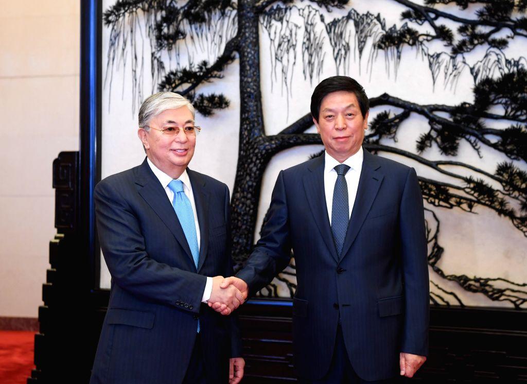 BEIJING, Sept. 12, 2019 - Li Zhanshu, chairman of the Standing Committee of China's National People's Congress, meets with Kazakh President Kassym-Jomart Tokayev in Beijing, capital of China, Sept. ...