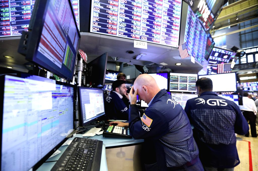 BEIJING, Sept. 13, 2019 - Traders work at the New York Stock Exchange in New York, the United States, Aug. 2, 2019.