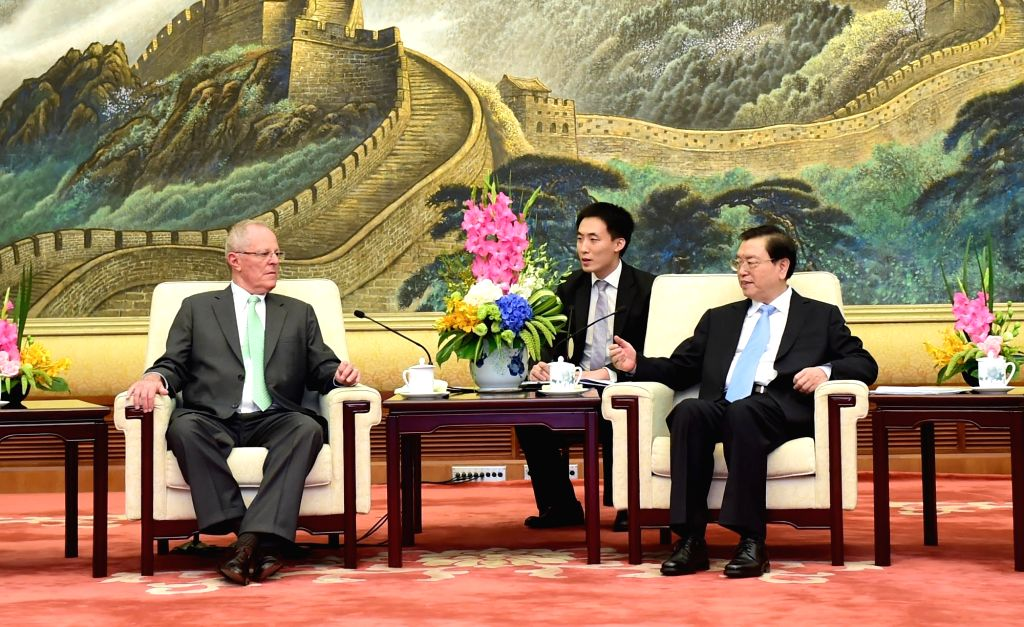 BEIJING, Sept. 14, 2016 - Zhang Dejiang (front R), chairman of the Standing Committee of China's National People's Congress (NPC), meets with visiting Peruvian President Pedro Pablo Kuczynski in ...