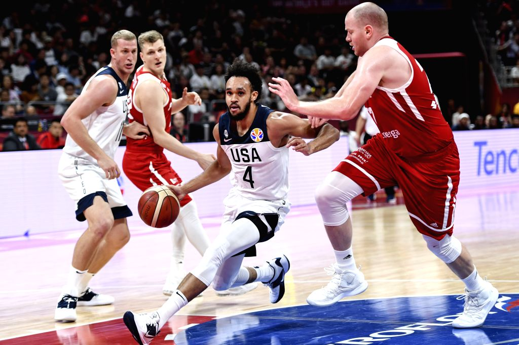 BEIJING, Sept. 14, 2019 - Derrick White (2nd R) breaks through during the Classification Games 7-8 between the United States and Poland at the 2019 FIBA World Cup in Beijing, capital of China, on ...