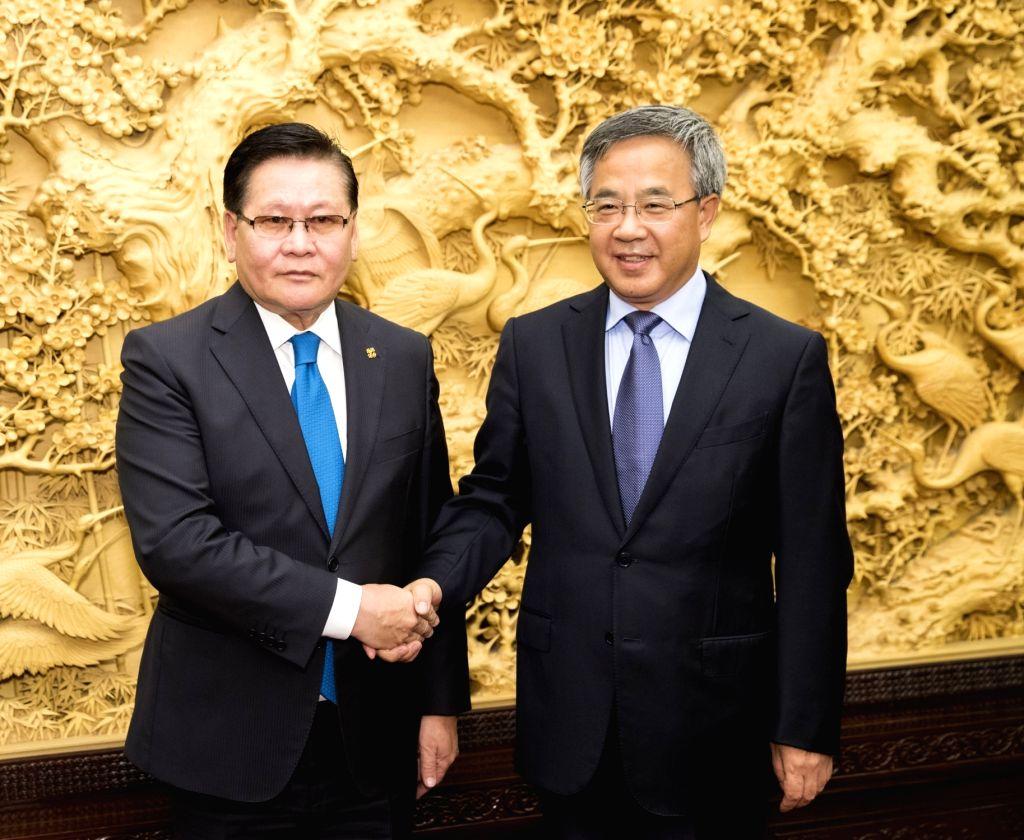 BEIJING, Sept. 19, 2018 - Chinese Vice Premier Hu Chunhua (R) meets with Mongolian Deputy Prime Minister Ulziisaikhan Enkhtuvshin in Beijing, capital of China, Sept. 17, 2018. - Ulziisaikhan Enkhtuvshin