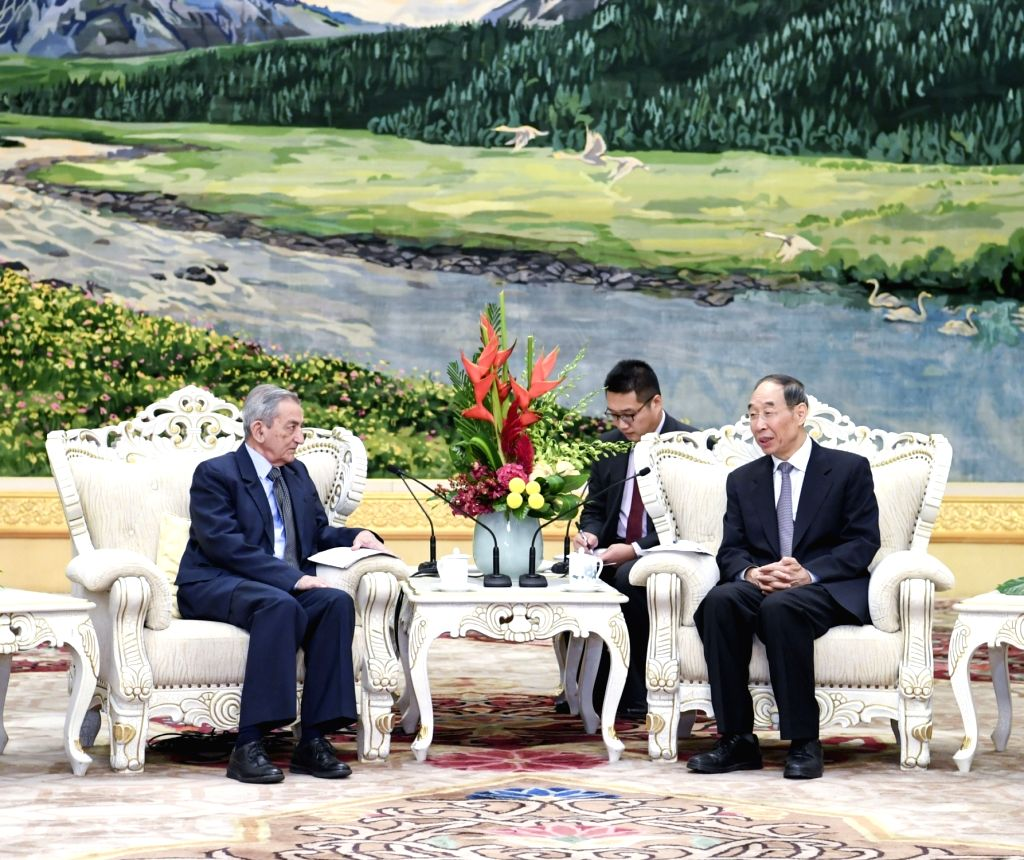 BEIJING, Sept. 19, 2018 - You Quan (R), a member of the Secretariat of the Communist Party of China (CPC) Central Committee and head of the United Front Work Department of the CPC Central Committee, ...