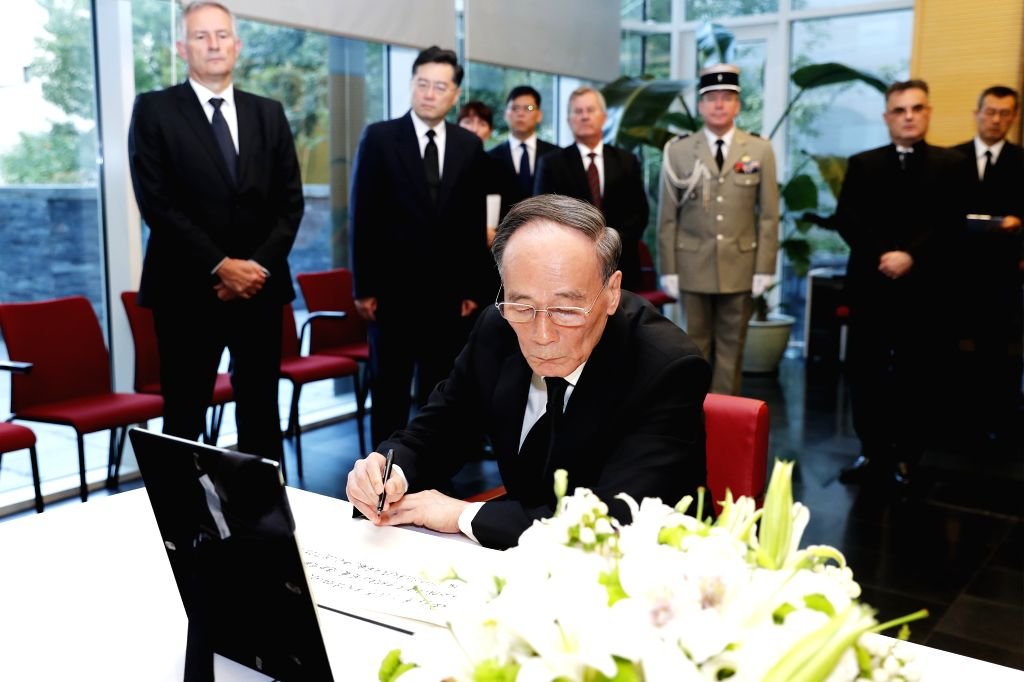 BEIJING, Sept. 28, 2019 - Chinese Vice President Wang Qishan mourns the passing of former French President Jacques Chirac at the French embassy in Beijing, capital of China, Sept. 28, 2019. Chirac ...