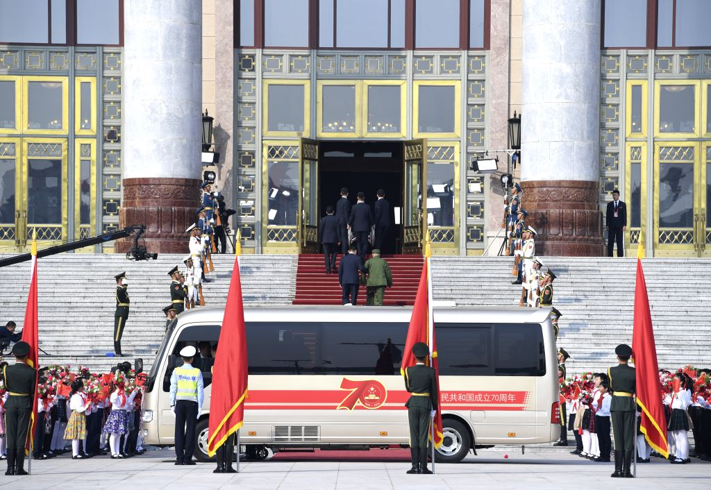 BEIJING, Sept. 29, 2019 - Awardees of China's national medals and honorary titles arrive at the Great Hall of the People in Beijing, capital of China, Sept. 29, 2019.