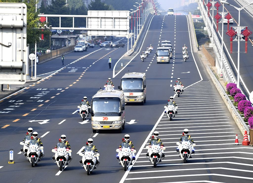 BEIJING, Sept. 29, 2019 - Escorted by a motorcade, awardees of China's national medals and honorary titles head for the Great Hall of the People in Beijing, capital of China, Sept. 29, 2019.