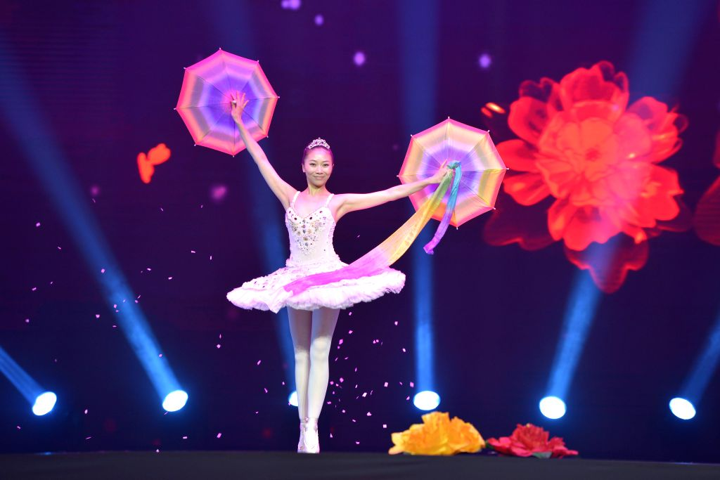Chinese magician Ma Yanyan performs during the closing ceremony of the Second China Beijing International Magic Carnival at the Changping District Gymnasium in ...