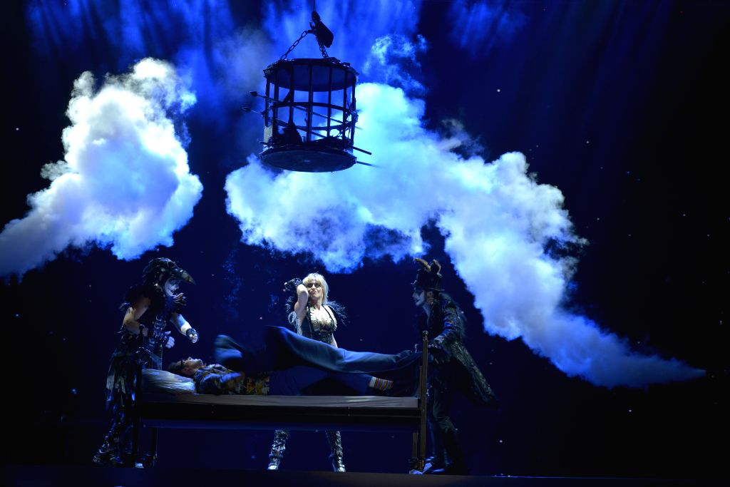 Magicians from the Netherlands perform during the closing ceremony of the Second China Beijing International Magic Carnival at the Changping District Gymnasium in ..