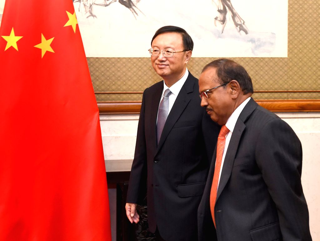 Chinese State Councilor Yang Jiechi (L) holds talks with Ajit Doval, special envoy and national security adviser to Indian Prime Minister Narendra Modi, in Beijing, - Narendra Modi