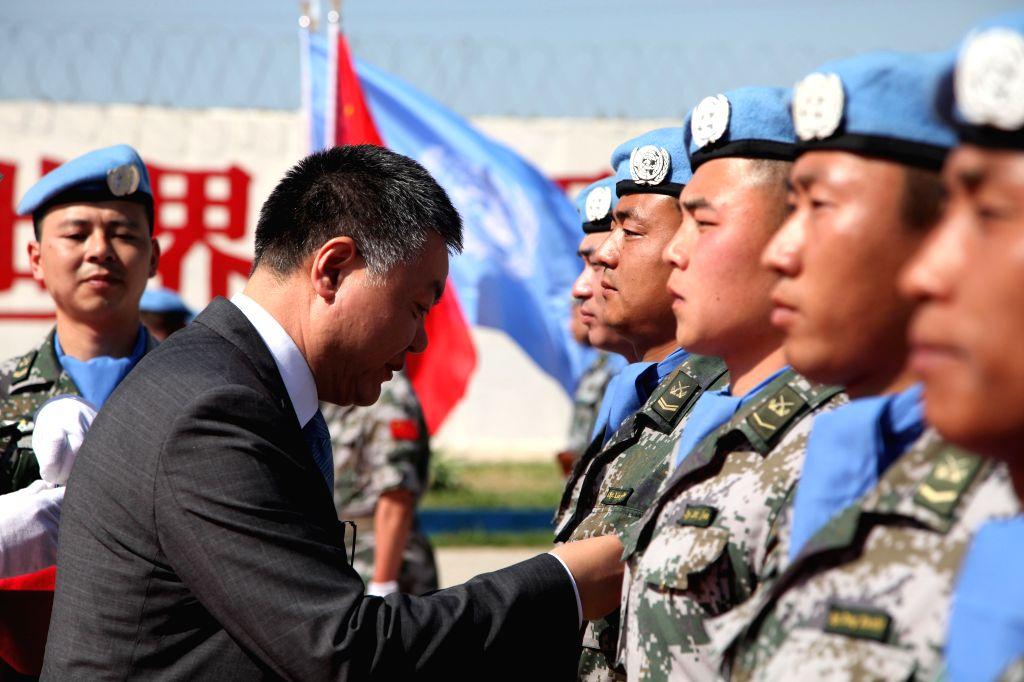 BEIRUT, April 6, 2018 - Chinese Ambassador to Lebanon Wang Kejian (L, Front) awards Chinese peacekeepers the United Nations Peace Medal of Honor at the awarding ceremony at the camp of the Chinese ...