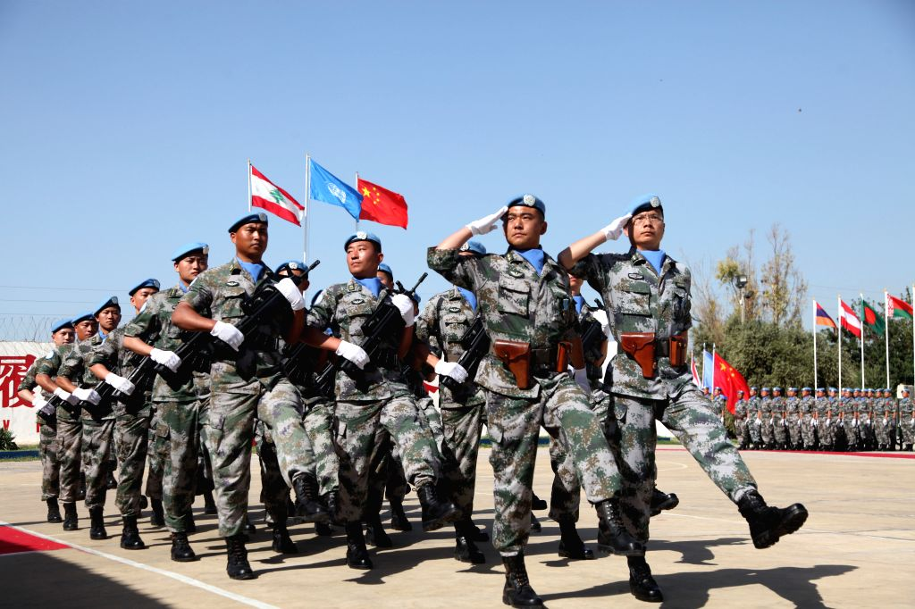 BEIRUT, April 6, 2018 - Chinese peacekeepers to Lebanon parade at the medal-awarding ceremony at the camp of the Chinese peacekeeping multi-functional engineer detachment to Lebanon in Hanniyah ...