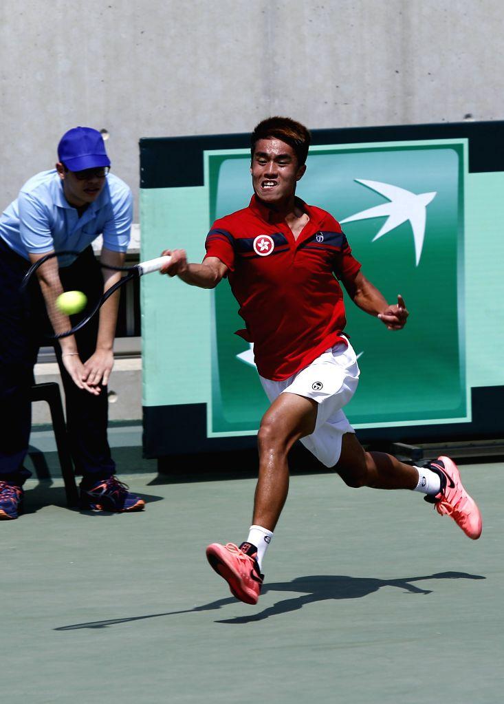 BEIRUT, April 7, 2018 - Wong Hong Kit of China's Hong Kong returns a shot to Benjamin Hassan of Lebanon during a game of Asia/Oceania group of the Davis Cup in Beirut, Lebanon, on April, 7, 2018. - Hassan