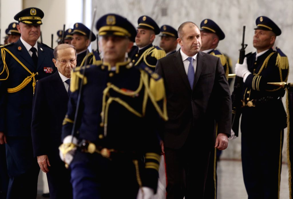 BEIRUT, April 9, 2019 - Lebanese President Michel Aoun (center L) and Bulgarian President Rumen Radev (center R) inspect the guards of honor at the Presidential Palace in Baabda, Lebanon, on April 9, ...