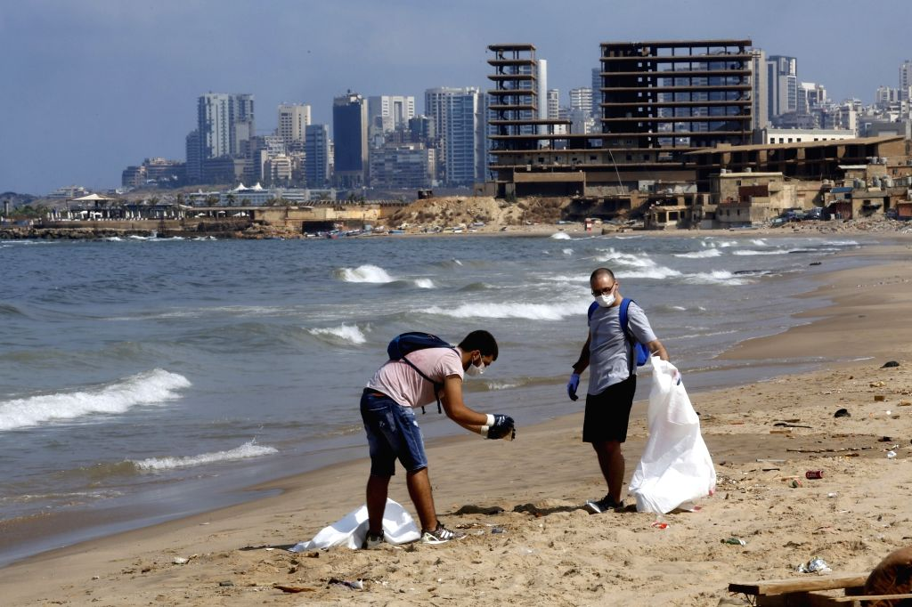 "BEIRUT, Aug. 25, 2018 (Xinhua) -- Lebanese environmental activists clean the beach of ""San Michel"", which faces serious pollution, at south of Beirut, Lebanon, Aug. 25, 2018. (Xinhua/Bilal Jawich/IANS)"