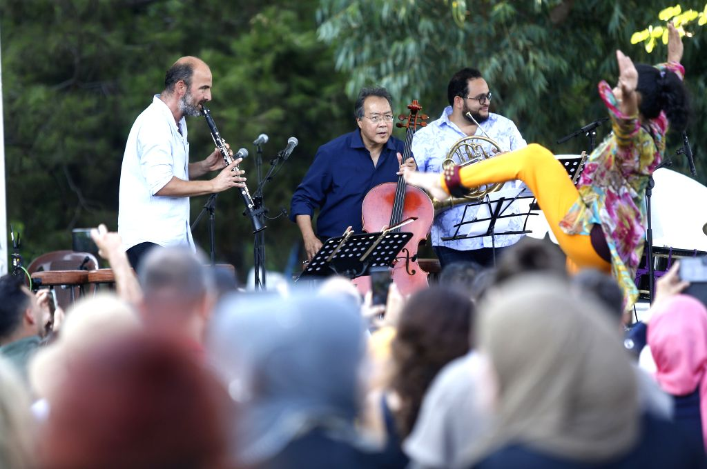 BEIRUT, Aug. 25, 2019 - Cellist Yo-Yo Ma (2nd L, rear) performs during a street concert in Beirut, Lebanon, on Aug. 25, 2019. About 300 youths and children from Lebanon, Syria, Palestine and other ...
