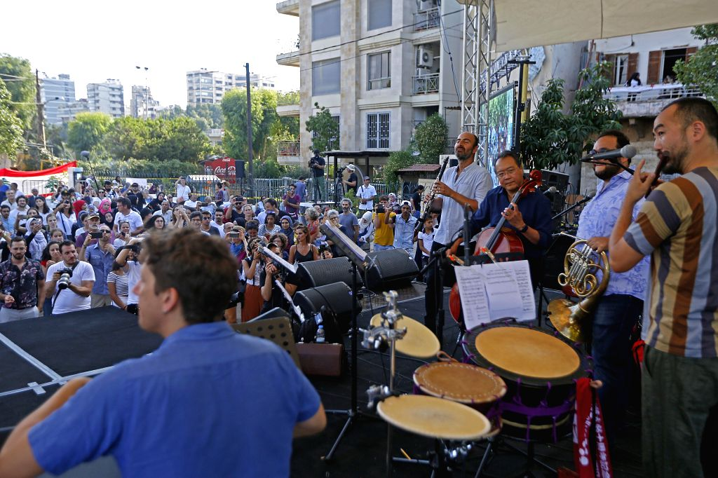 BEIRUT, Aug. 25, 2019 - Cellist Yo-Yo Ma (3rd R) performs during a street concert in Beirut, Lebanon, on Aug. 25, 2019. About 300 youths and children from Lebanon, Syria, Palestine and other places ...