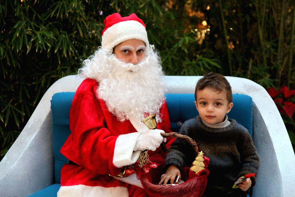 Santa Claus gives a boy candy at a mall in Beirut, Lebanon, Dec. 20, 2013.