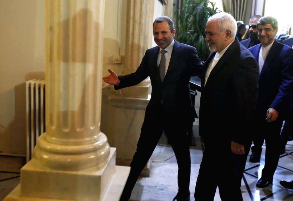 BEIRUT, Feb. 11, 2019 - Lebanese Foreign Minister Gebran Bassil (L) welcomes visiting Iranian Foreign Minister Mohammad Javad Zarif in Beirut, Lebanon, on Feb. 11, 2019. - Gebran Bassil