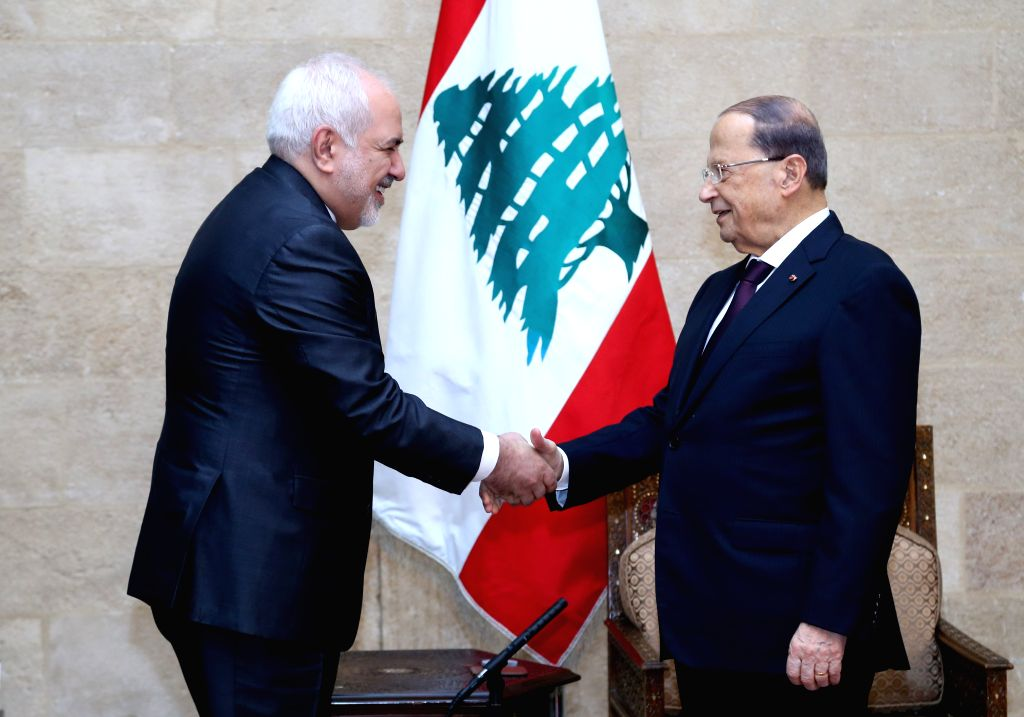 BEIRUT, Feb. 11, 2019 - Lebanese President Michel Aoun (R) shakes hands with visiting Iranian Foreign Minister Mohammad Javad Zarif in Beirut, Lebanon, Feb. 11, 2019. - Mohammad Javad Zarif