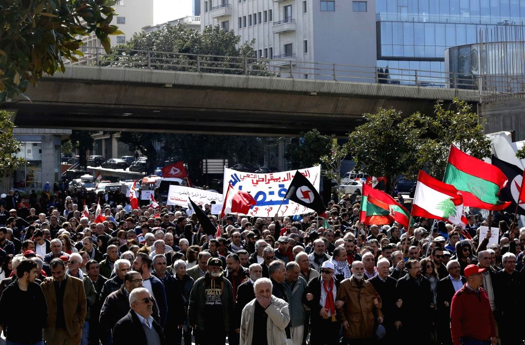 BEIRUT, Feb. 17, 2019 - Protesters hold flags and banners during a protest in Beirut, capital of Lebanon, Feb. 17, 2019. Hundreds of Lebanese on Sunday protested in capital Beirut's downtown against ...