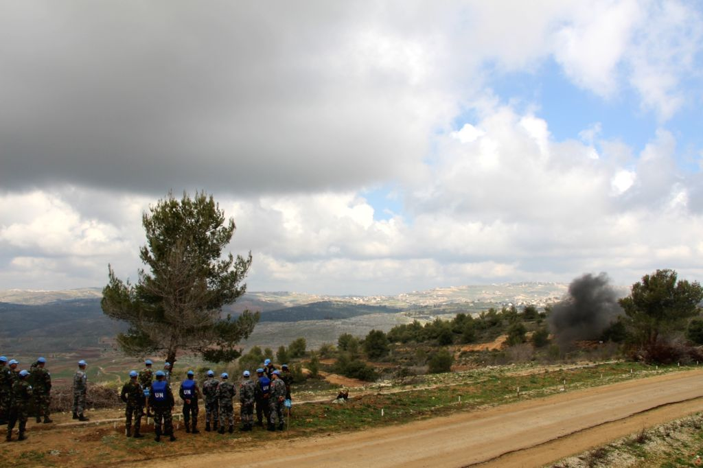 BEIRUT, Feb. 21, 2019 - Chinese and Cambodian peacekeepers watch a mine-sweeping mission organized by the Chinese side in a minefield near the Blue Line, a border between Lebanon and Israel, on Feb. ...