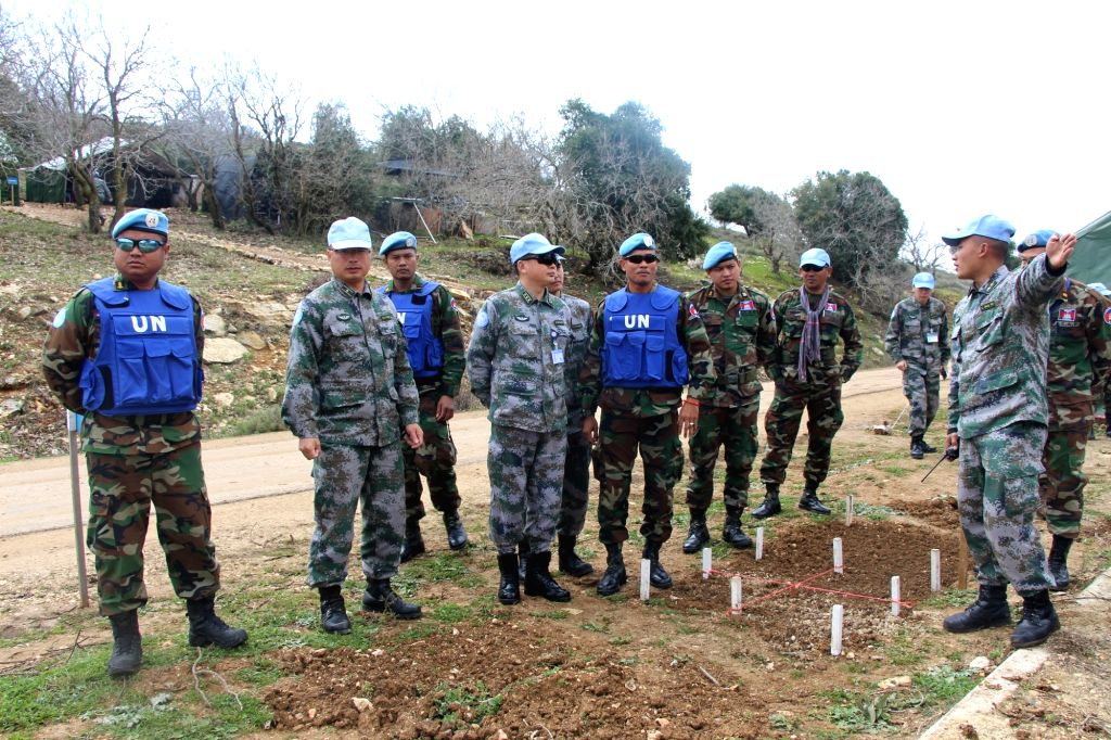 BEIRUT, Feb. 21, 2019 - Chinese peacekeepers introduce mine-sweeping experience to their Cambodian colleagues in a minefield near the Blue Line, a border between Lebanon and Israel, on Feb. 19, 2019. ...