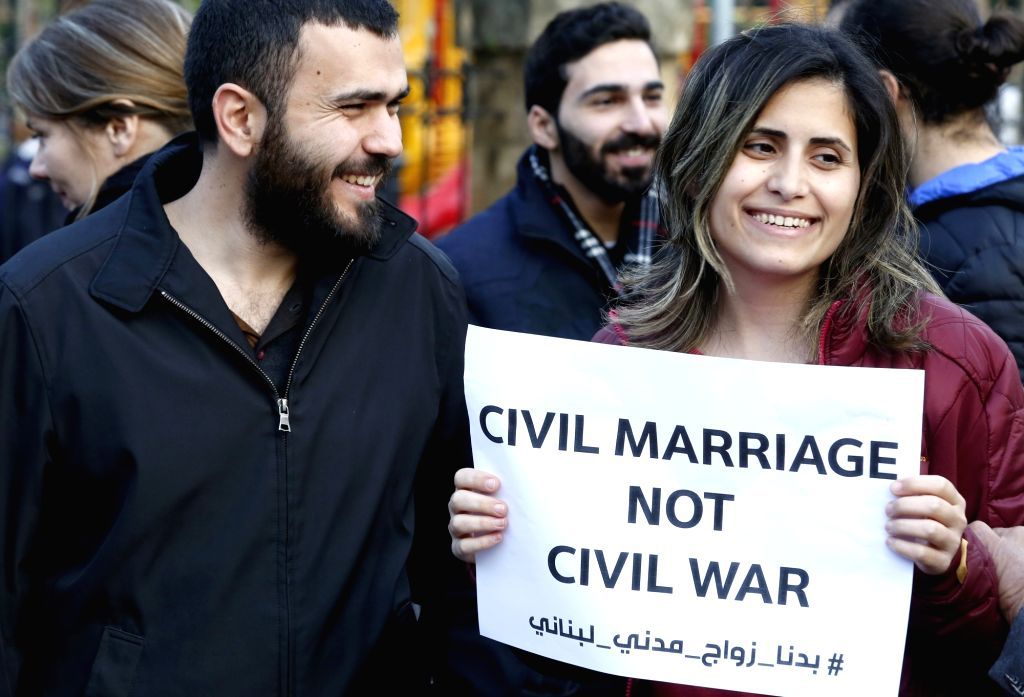 BEIRUT, Feb. 23, 2019 - Protestors hold banners calling for permission of civil marriage, in Beirut, Lebanon, Feb. 23, 2019. Tens of Lebanese citizens protested on Saturday near the Interior Ministry ...