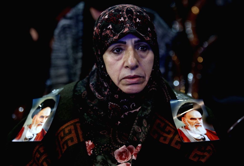 BEIRUT, Feb. 6, 2019 - A woman attends a rally to celebrate the 40th anniversary of the victory of Iran's Islamic revolution in Beirut, Lebanon, on Feb. 6, 2019.