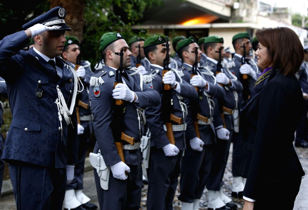 BEIRUT, Feb. 6, 2019 - Newly appointed Interior Minister Raya El Hassan (R) reviews honor guards during a ceremony at the interior ministry in Beirut, Lebanon, Feb. 6, 2019. Raya El Hassan took her ... - Raya E