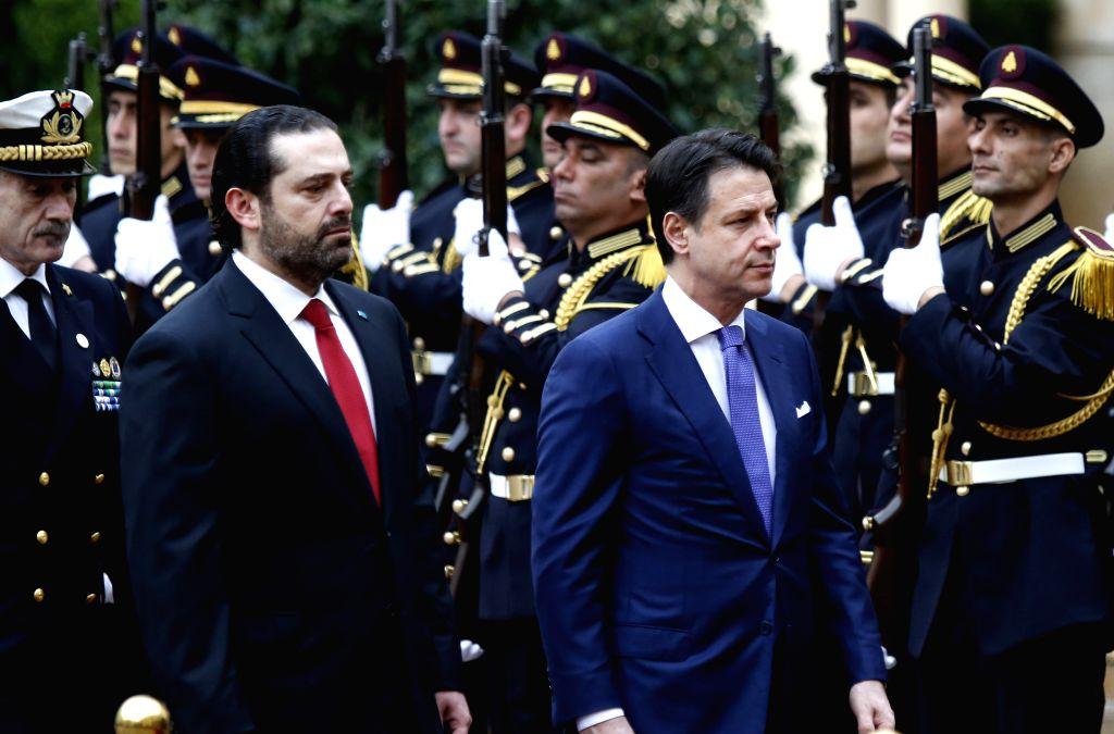 BEIRUT, Feb. 7, 2019 - Lebanese Prime Minister Saad Hariri (L) and Italian Prime Minister Giuseppe Conte inspect the guard of honor in Beirut, Lebanon, Feb. 7, 2019. - Saad Hariri