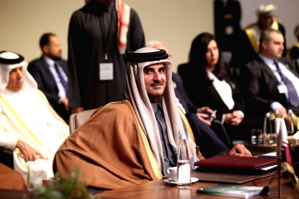 BEIRUT, Jan. 20, 2019 (Xinhua) -- Qatari Emir Sheikh Tamim bin Hamad Al Thani attends the fourth Arab Economic and Social Development Summit in Beirut, Lebanon, Jan. 20, 2019. The fourth Arab Economic and Social Development Summit on Sunday kicked of - Emir Sheikh Tamim