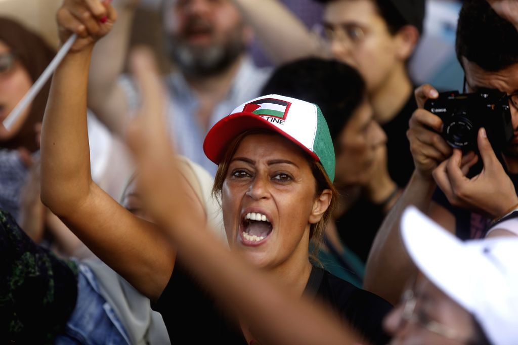 BEIRUT, July 18, 2019 - A Palestinian refugee takes part in a protest in Beirut, Lebanon, on July 16, 2019. A large number of Palestinians in Beirut held protests against an initiative from Lebanese ...
