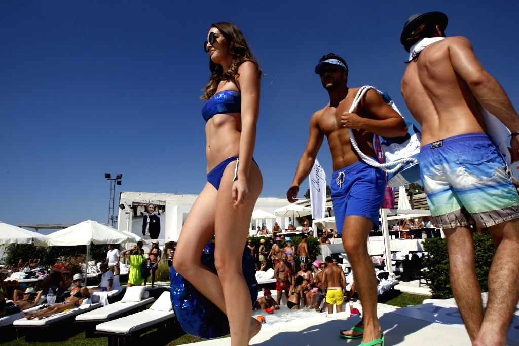 Models present the latest summer collection from Diamony during Lebanon Summer Fashion Festival held in the pool area in southern Beirut on June 15, 2014.