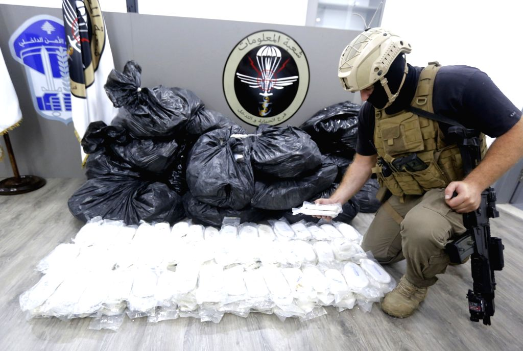 BEIRUT, June 5, 2018 - A member of the Lebanese Internal Security Forces (ISF) displays seized hashish during a press conference in Beirut, Lebanon, June 4, 2018. The ISF seized recently over 15 tons ...