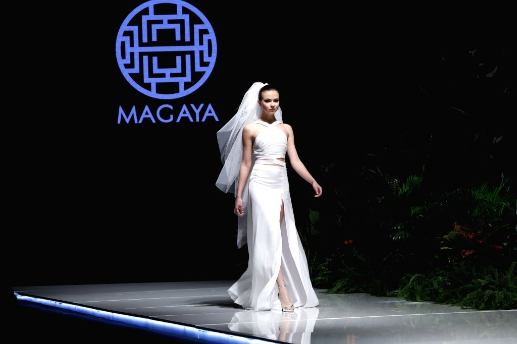 """BEIRUT, March 22, 2018 - A model presents a creation of Lebanese designer Magaya during the show """"Designers & Brands Event"""" in Beirut, capital of Lebanon, on March 22, 2018. ..."""