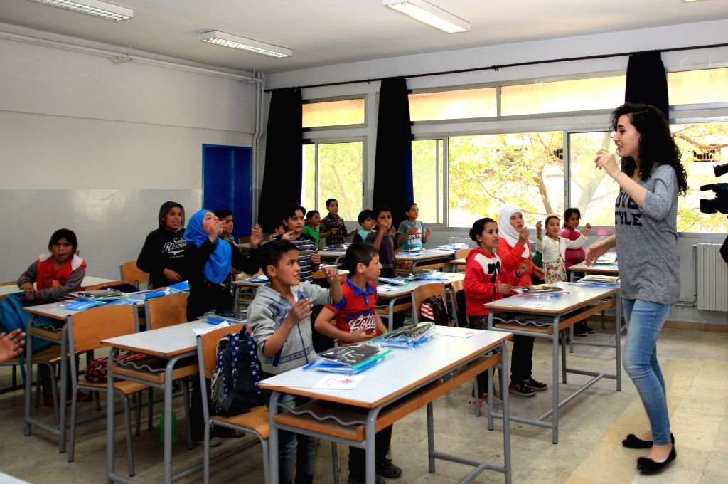 BEIRUT, May 12, 2017 - Syrian refugee children have a class at a school in Bekaa town, Lebanon, on May 12, 2017. China's ambassador to Lebanon Wang Kejian delivered Friday school supplies valuing 1 ...