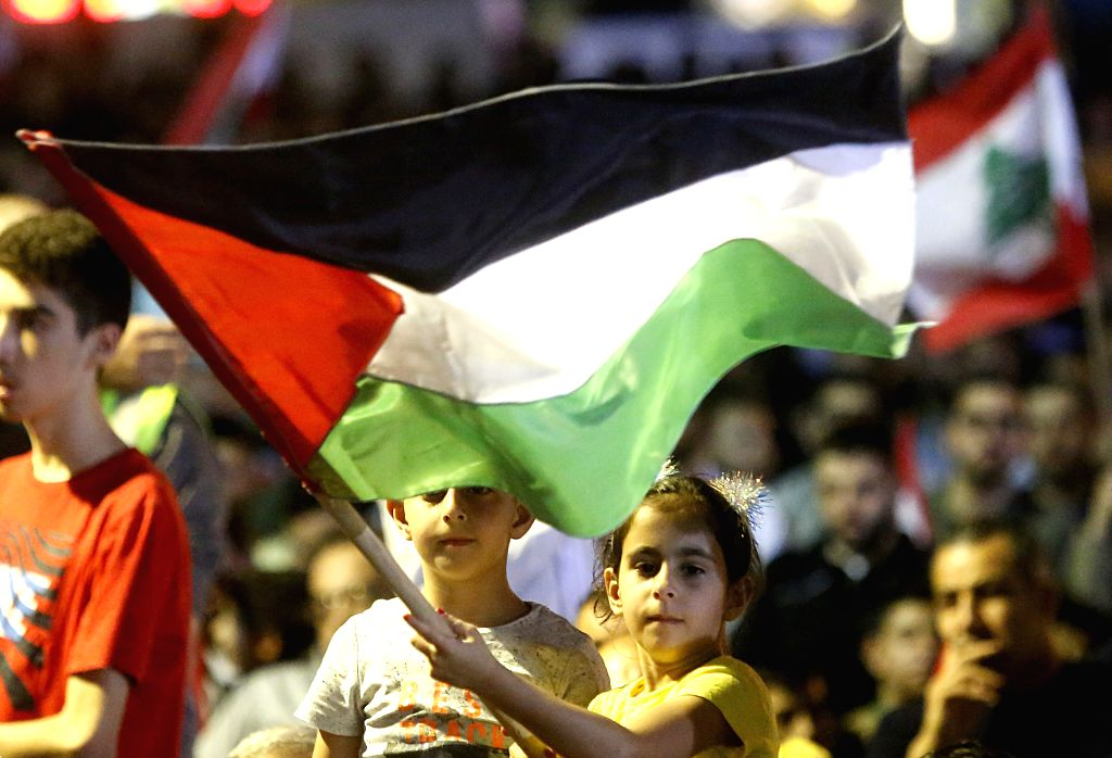 BEIRUT, May 31, 2019 - A girl holds a Palestinian flag during a rally in the southern suburb of Beirut, Lebanon, on May 31, 2019. Hezbollah leader Sayyed Hassan Nasrallah on Friday vowed to fight ... - Sayyed Hassan Nasrallah
