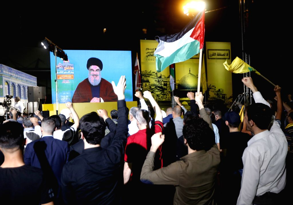 BEIRUT, May 31, 2019 - Supporters listen to Hezbollah leader Sayyed Hassan Nasrallah's speech on a screen during a rally in the southern suburb of Beirut, Lebanon, on May 31, 2019. Hezbollah leader ... - Sayyed Hassan Nasrallah