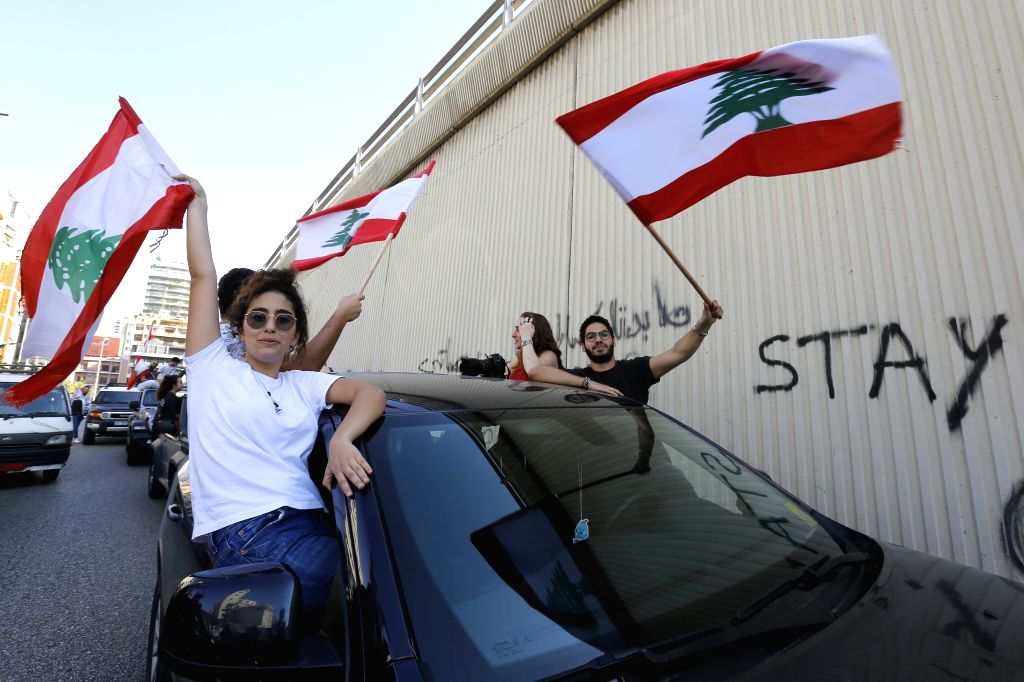 BEIRUT, Nov. 12, 2019 - People take part in a protest in Beirut, Lebanon, on Nov. 12, 2019. Lebanese President Michel Aoun on Tuesday called on the protesters to leave the streets, while assuring ...